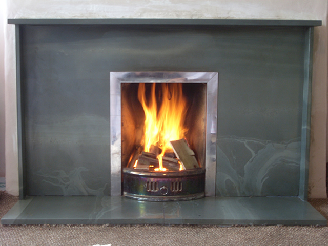 Smooth finished slate fireplace