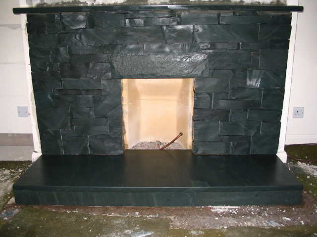 dark gray slate brick fireplace